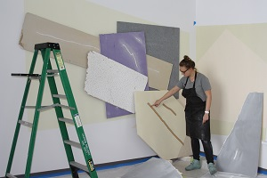 Katie Bell works on installation