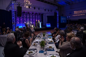 Guests applauding at 50th Anniversary Gala