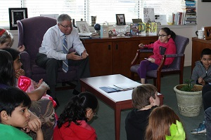 Dr. Ender meets with Ambassador School students in his office