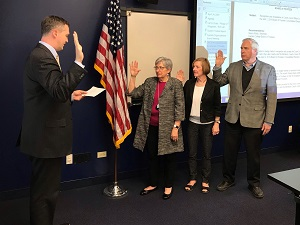 Pat Stack, Nancy Robb and Bill Kelley being sworn in as new board officers