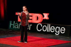 Bree Bogucki speaks on stage at TEDx event