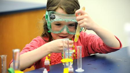 A girl conducts a science experiment