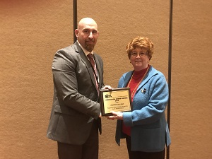 Dean Rebecca Lake receives the award from ICCCA President-elect Michael Boyd