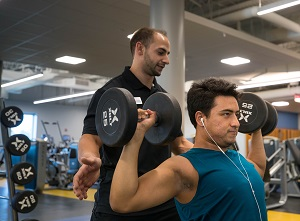 Harper College personal trainer Joe Mago works with a client