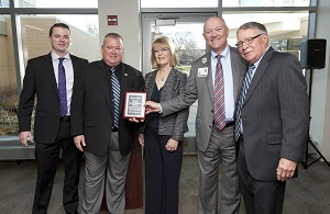 Harper recognizes Northwest Community Healthcare with a plaque