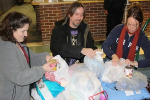 A community member donates to Santa Claus for Paws