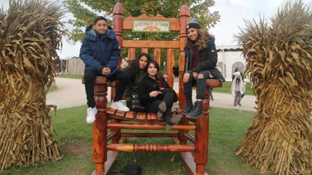 Silvia Astudillo with her family at the pumpkin patch