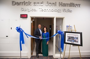 Derrick and Joni Hamilton cut the ribbon