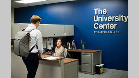 A University Center employee welcomes a student