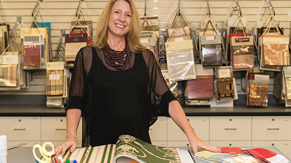 Alison Walwark standing with fabric samples