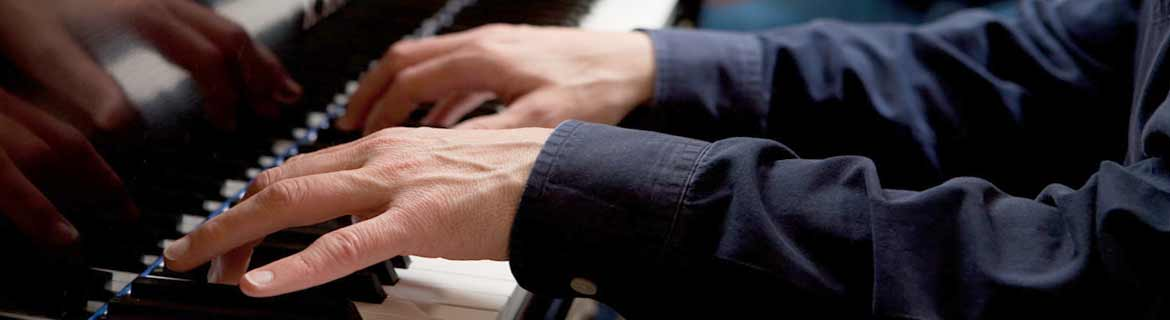 Hands playing the piano