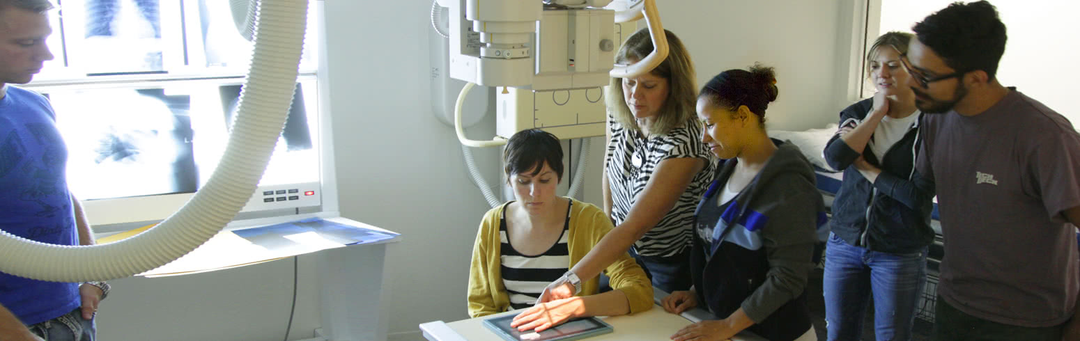 Woman getting hand examine with professionals using radio logic technology