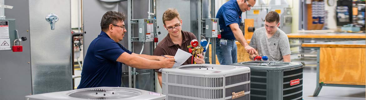 Students learn HVAC system repair in Harper's state-of-the-art lab