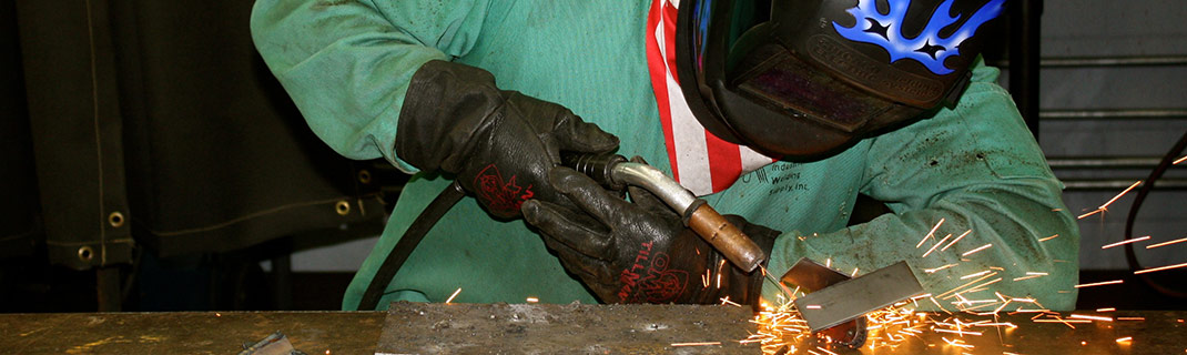 Man working with welding technology and machinery