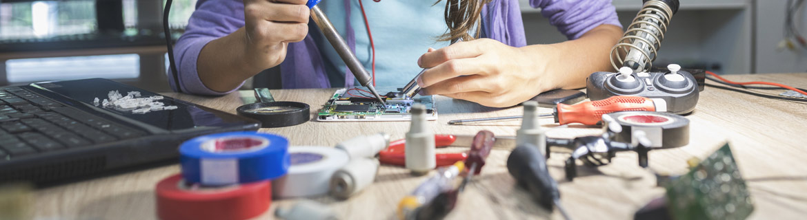 Girl modifying engineering circuits hands-on