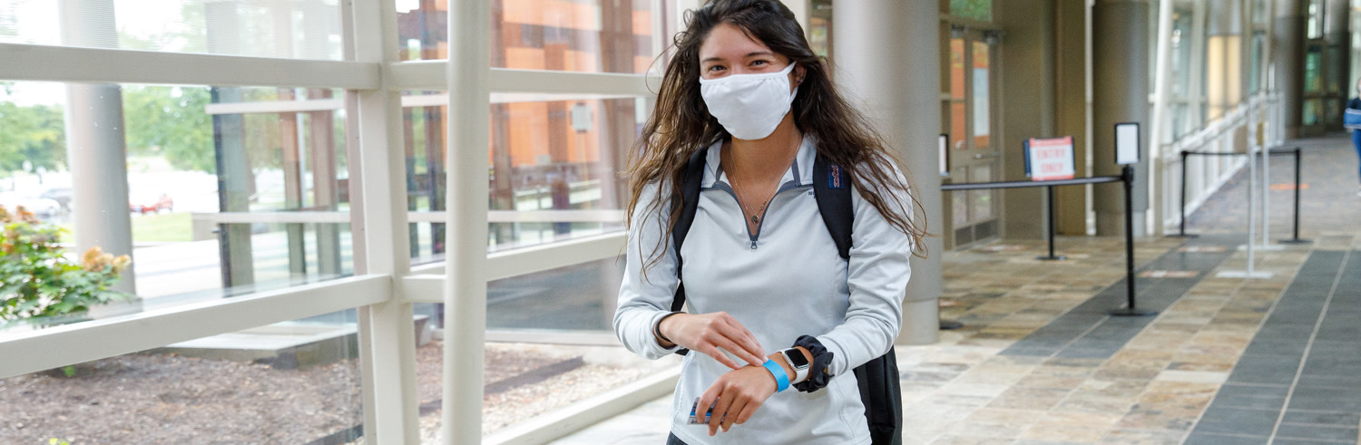 Student with mask on campus