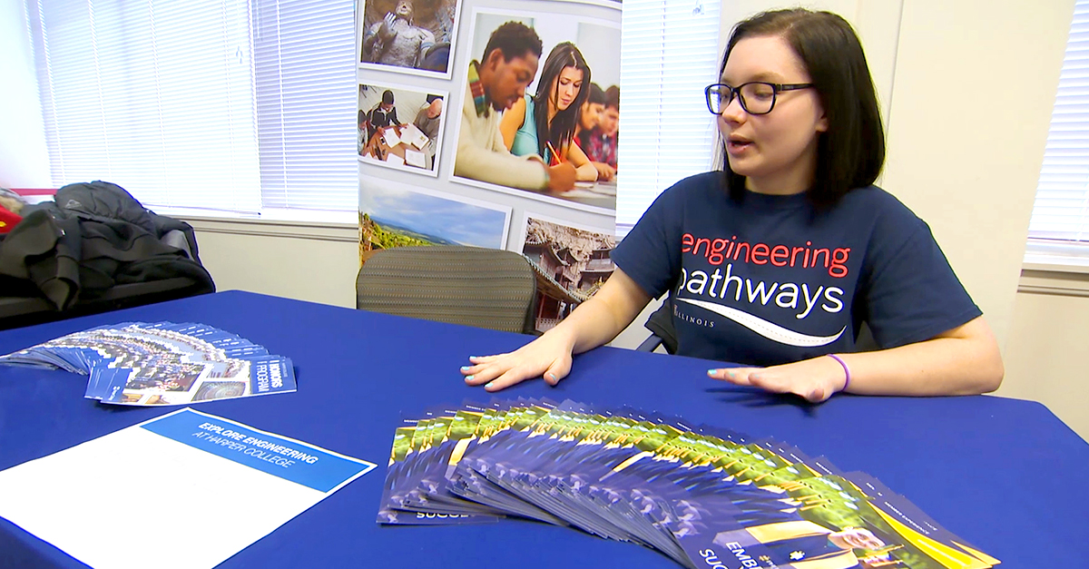 Engineering Pathways student with pamphlets