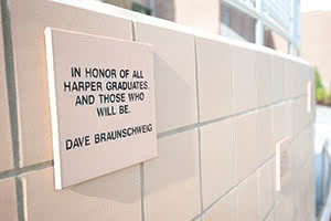 "Paver outside of D Building, ""In honor of all Harper graduates, and those who will be. Dave Braunschweig"""