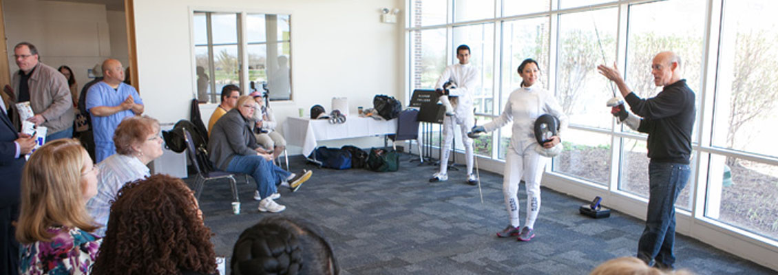 Harper instructor with fencing students
