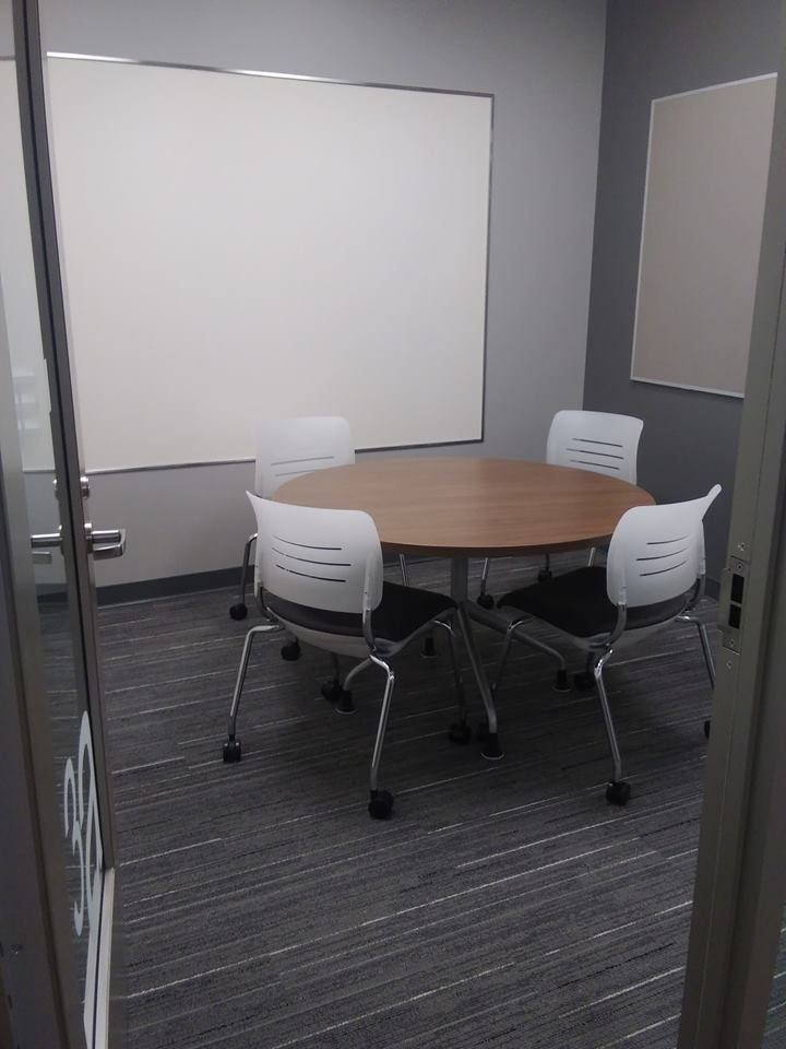 Study room with table, chairs, and whiteboard