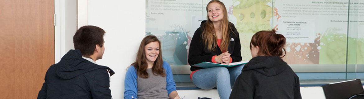 group of smiling students studying