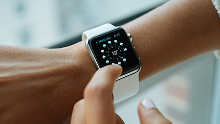 Photo of an apple watch on a wrist.