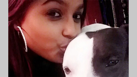 Sushila Jackson kisses her dog on the head